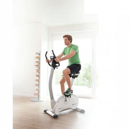 Bicicleta de ejercicio Paros Pro volante inercia 11 kg en acción, poco espacio y elegancia
